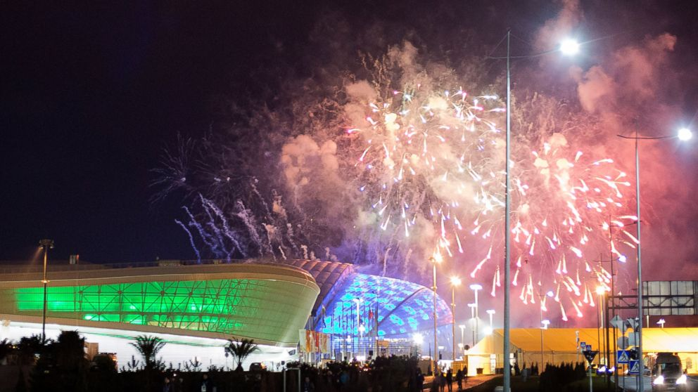PHOTO: Fireworks are shot over Fisht Olympic Stadium, right, and Adler Arena, left, at the conclusion of a rehearsal for the opening ceremony at the 2014 Winter Olympics, Saturday, Feb. 1, 2014, in Sochi, Russia.