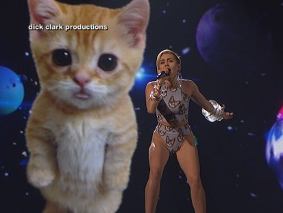 "VIDEO: Mileys AMA performance of ""Wrecking Ball"" includes a lip-synching, crying feline in space."