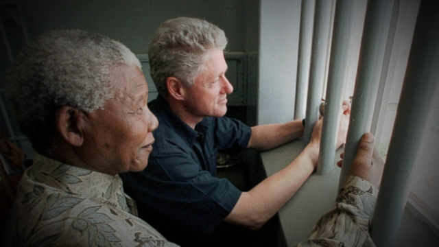 "Clinton compares Mandela to Mahatma Gandhi, says he ""symbolized the world wed all like to live in."""