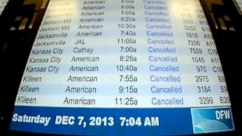 Hundreds of flights grounded following ice storm, thousands spend second night in airport.