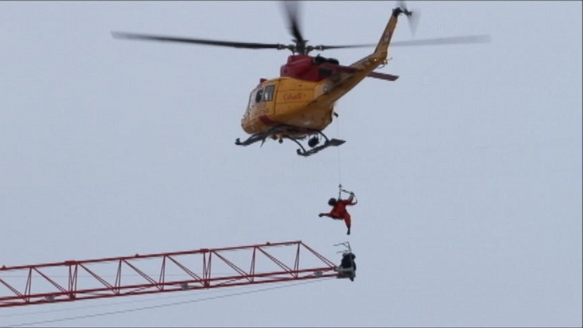 VIDEO: In Ontario, one man hung on as he waited for more than an hour to be rescued by helicopter.