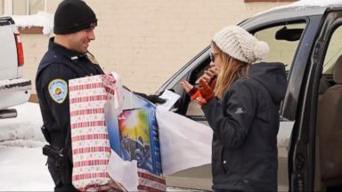 VIDEO: WN 12/24: Santas Helpers in Uniform Spread Good Cheer