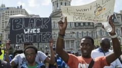 Curfew Lifted in Baltimore as Peaceful Demonstrations Continue