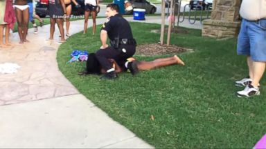 Now Playing Police Officer Seen Sitting On Teenage Girl At Texas Pool Party Resigns