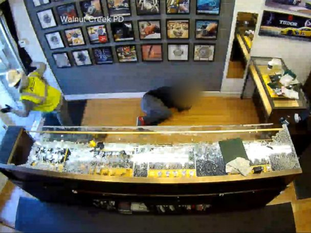 WATCH:  Surveillance cameras capture a jewelry store owner fighting back against robbers