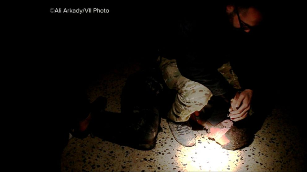 VIDEO: Photojournalist reveals graphic images of torture and execution by Iraqi troops