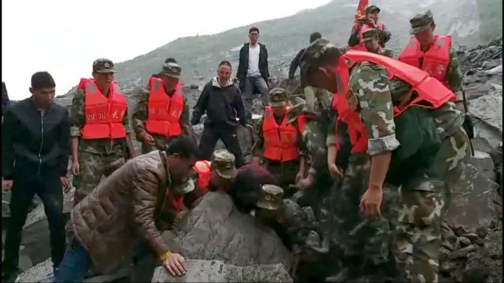 VIDEO: Desperate search for landslide survivors in China