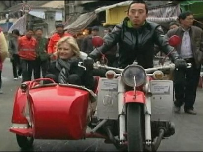 VIDEO: Watch Diane Sawyer sample delicious dumplings and ride a motorcycle.