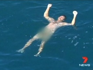 Watch: Shark Circles Naked Man Fighting for His Life