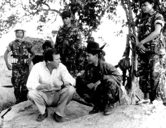 "Jennings talks with members of the non-communist forces on a military base inside the ""liberated zone"" in Cambodia"