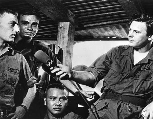Peter Jennings talks to U.S. troops in Vietnam. He was one of the first reporters who went to Vietnam in the 1960s.
