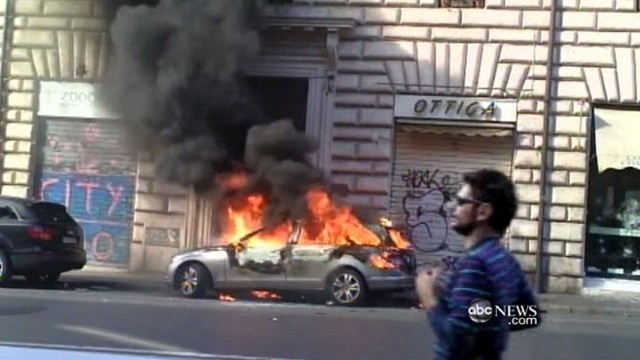 VIDEO: Demonstrators surge in Times Square, protest in Berlin and set fires in Rome.