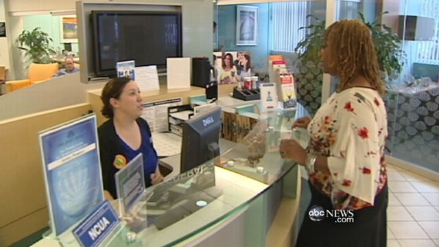 VIDEO: New debit fees compel many Americans to switch to credit unions.