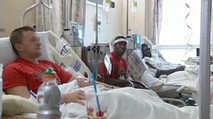VIDEO; Football Team Lands in Hospital