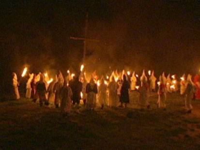 A picture of a Ku Klux Klan rally.