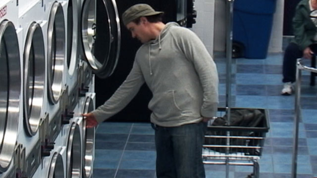 PHOTO a laundry thief who starts taking clothes from the machine the customer has been entrusted with