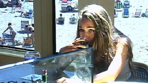 VIDEO: When stranger tries to lure drunk girl out of bar, a patron comes to her rescue.