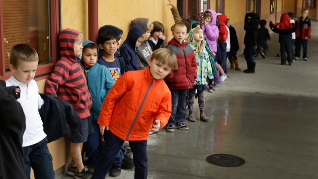 PHOTO: A first grade class of 30 children waits to enter a classroom Thursday, Jan. 24, 2013, at the Willow Glenn Elementary School in San Jose, Calif.