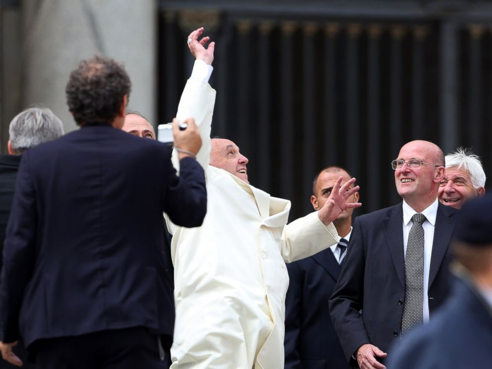 PHOTO: Pope Francis jumps to catch a baseball ball thrown by a faithful at the end of his weekly audience at St. Peters Square on Sept. 24, 2014 in Vatican City, Vatican.