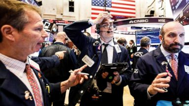 Dow ends flat, paring early losses after Chinese tech exec's arrest