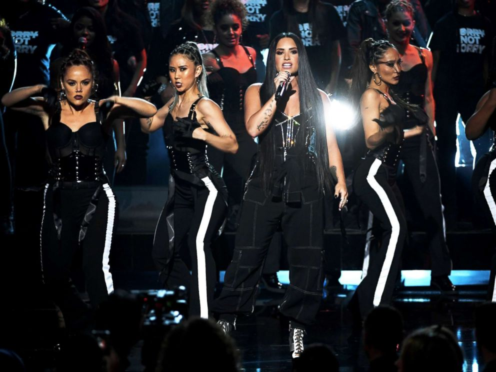 PHOTO: Demi Lovato, center, performs onstage during the 2017 American Music Awards at Microsoft Theater, Nov. 19, 2017, in Los Angeles.