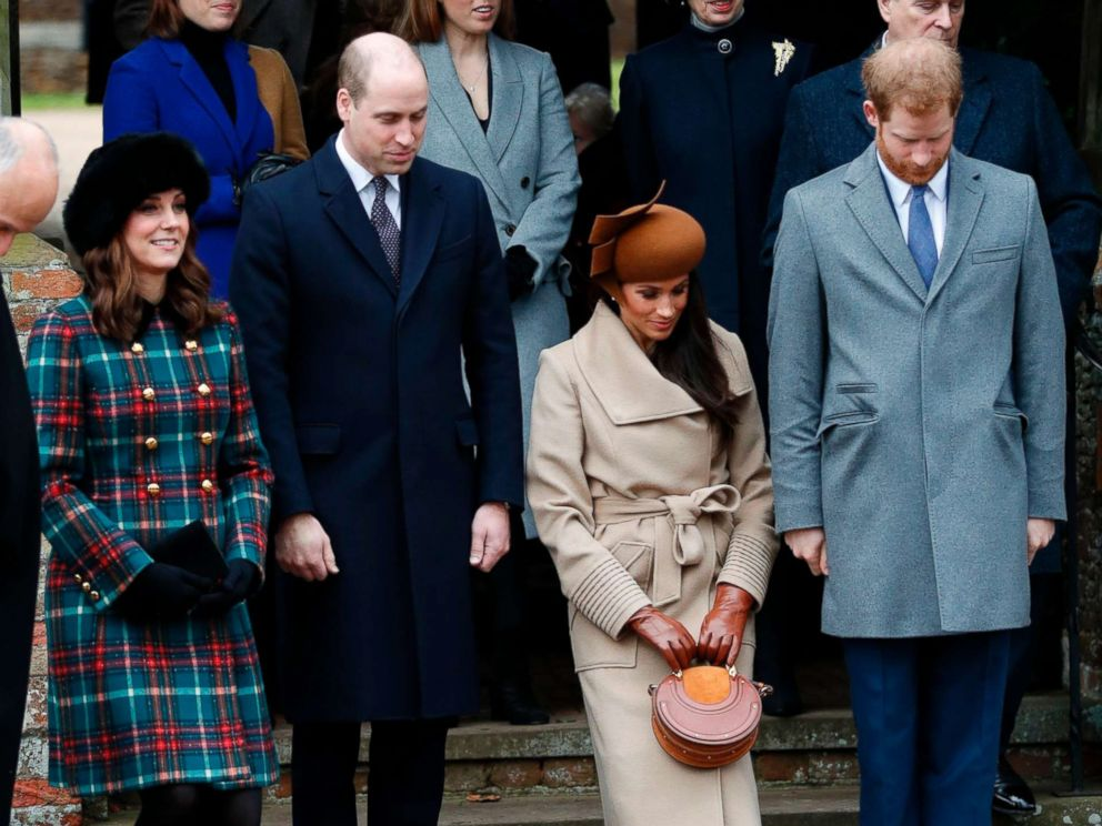 Meghan Markle walks down the stairs with her fiance Prince Harry and Prince William after church services at St. Mary Magdalene Church in Sandringham