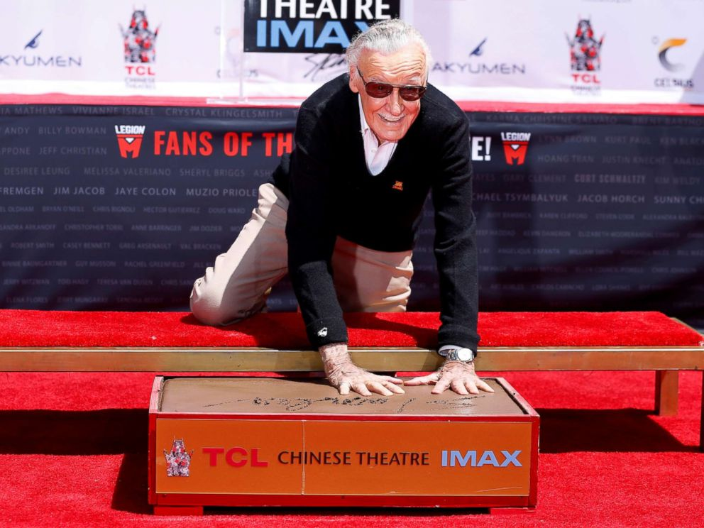 PHOTO: Marvel Comics co-creator Stan Lee places his handprints in cement during a ceremony at the TCL Chinese theatre in Los Angeles, July 18, 2017.
