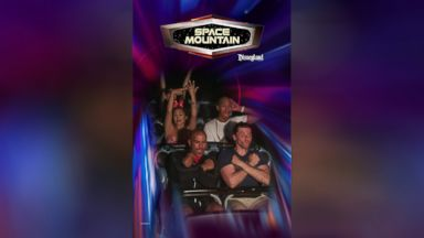 Woman flashing her engagement ring on Space Mountain is everything