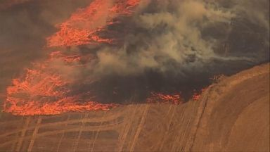 Deadly wildfires rage out West
