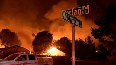 Deadly California fire burns over 90,000 acres