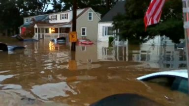 Homes, cars slammed by water amid flash floods in Northeast
