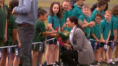 Meghan Markle and Prince Harry play with children during day 2 of Australia tour