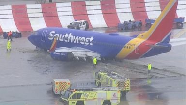 Passenger jet hydroplanes off runway amid California storms