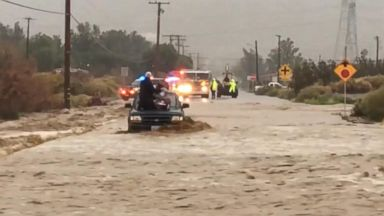 At least 1 dead as powerful storms slam West coast