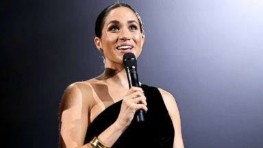 Meghan Markle's growing baby bump steals the show during surprise appearance at the British Fashion Awards