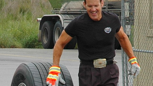 PHOTO: Bob Perry, Trucker Trainer and Rolling Strong Founderrolls a tire 63 miles in support of driver health and wellness.