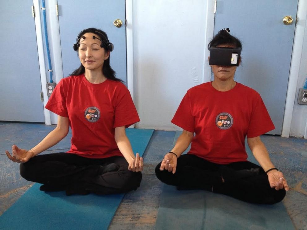 PHOTO: The crew participates in daily yoga and meditation sessions to offset the effects of isolation and confinement on Mars.