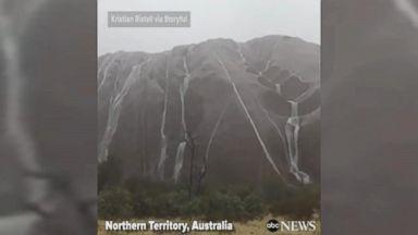 Australia's Uluru turns into temporary waterfall after rainfall