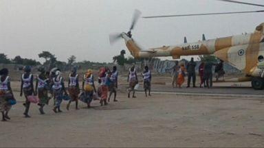 82 Nigerian schoolgirls freed by Boko Haram arrive in nation's capital