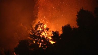 Large fire burns for 2nd day, threatens homes near Athens