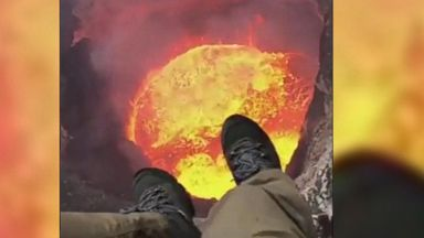 Helicopter pilot records himself dangling above volcano