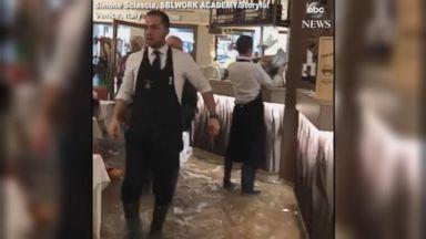 Venice pizzeria dishes out slices despite flooding