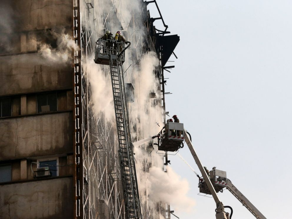 PHOTO: Iranian firefighters work to extinguish fire of the Plasco building in central Tehran, Iran, Jan. 19, 2017.