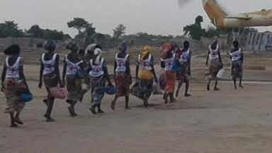 82 Nigerian schoolgirls freed by Boko Haram arrive in nation's capital