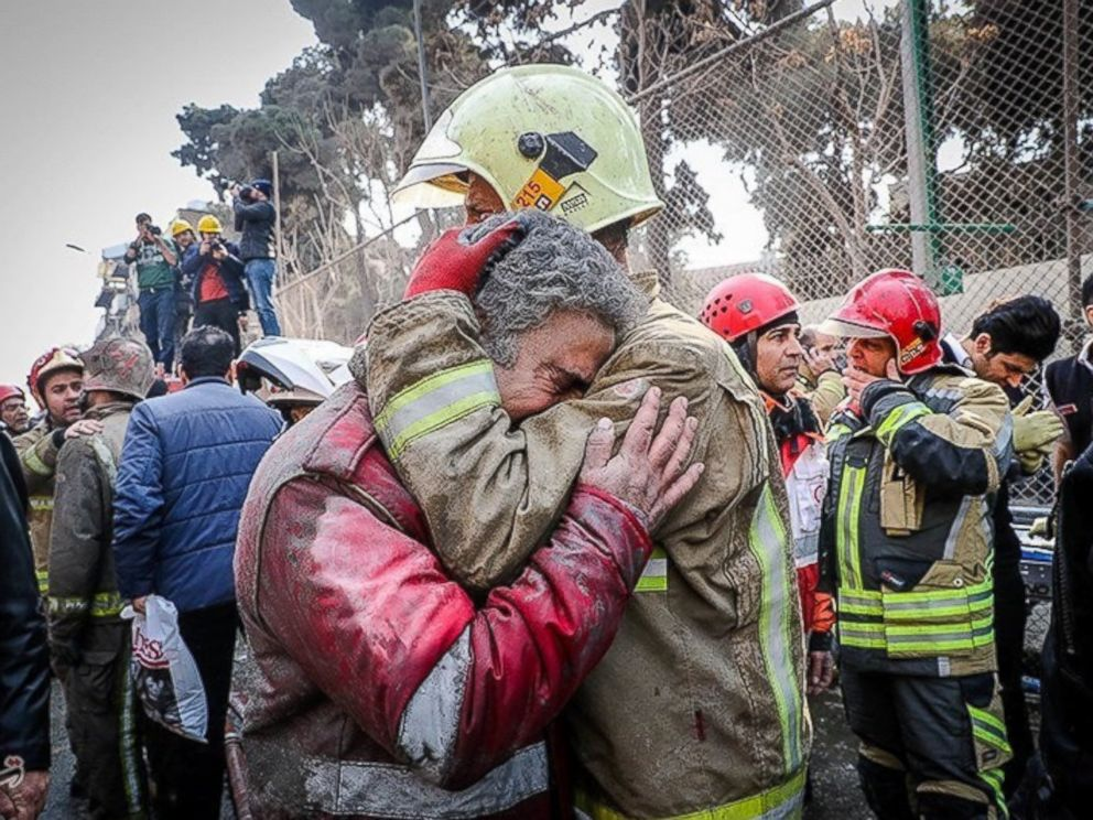 PHOTO: Firefighters react at the site of a collapsed high-rise building in Tehran, Iran Jan. 19, 2017.