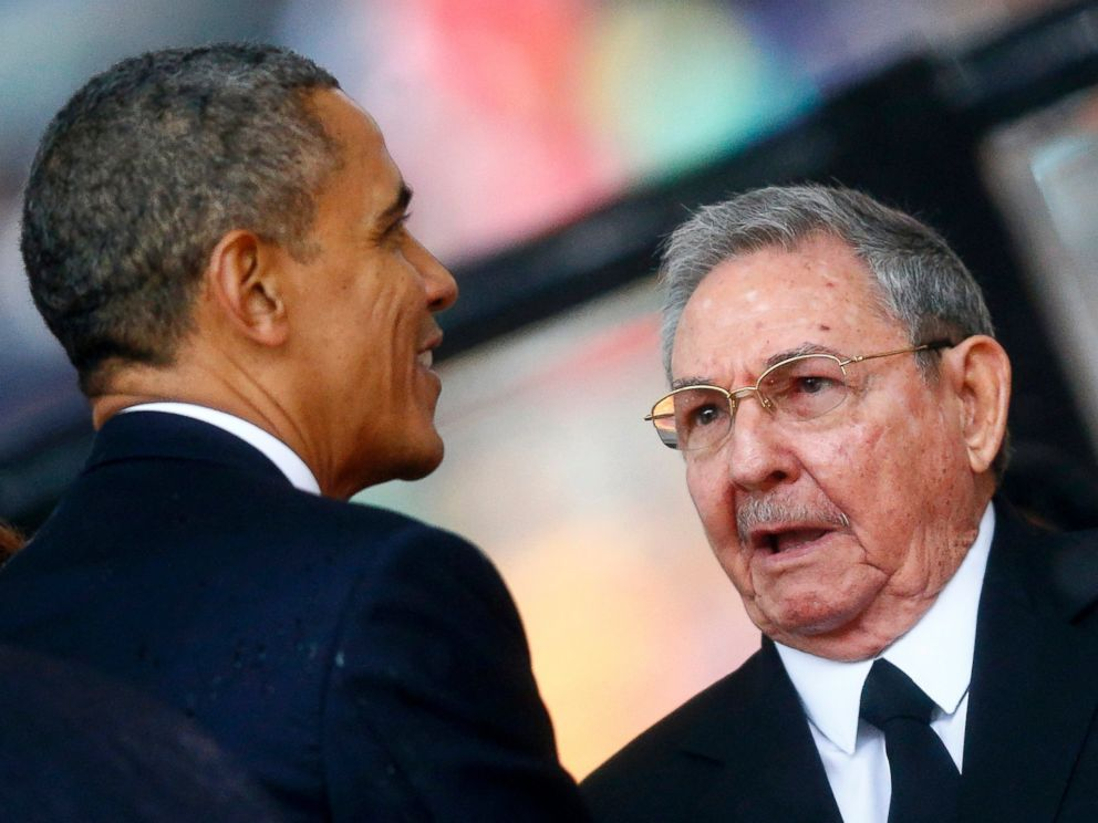 PHOTO: President Barack Obama greets Cuban President Raul Castro before giving his speech at the memorial service for Nelson Mandela at the First National Bank soccer stadium in Johannesburg, Dec. 10, 2013.