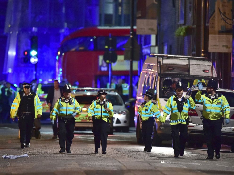 PHOTO: Police officers gather on Borough High Street as police deal with an incident on London Bridge in London, Saturday, June 3, 2017.