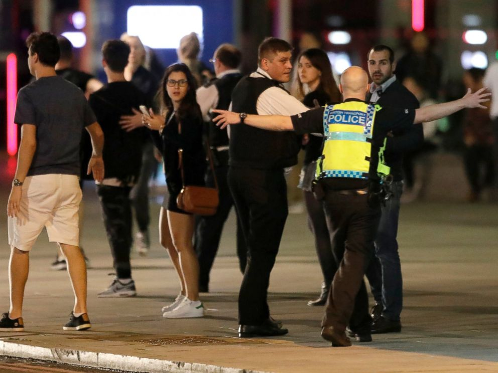 PHOTO: A police officer clears people away from the area near London Bridge after an incident in central London, June 3, 2017.