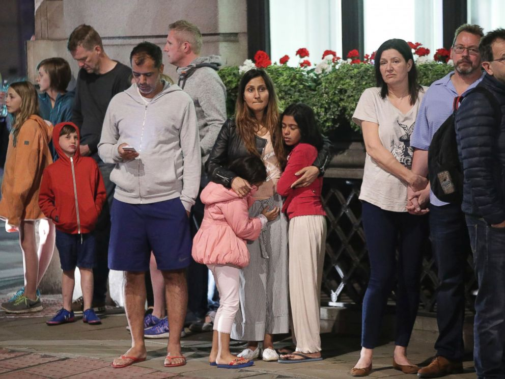 PHOTO: Guests from the Premier Inn Bankside Hotel are evacuated and kept in a group with police on Upper Thames Street following an incident in central London, June 3, 2017.