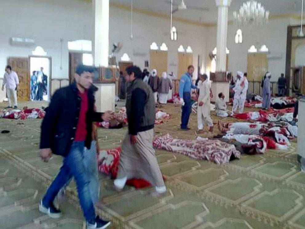 PHOTO: People stand over bodies of worshipers killed in attack on mosque in the northern city of Arish, Sinai Peninsula, Egypt, Nov. 24, 2017.